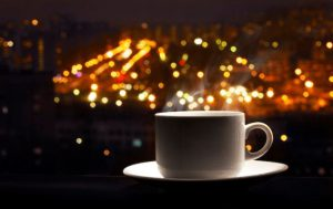 coffee cup & city in the backround